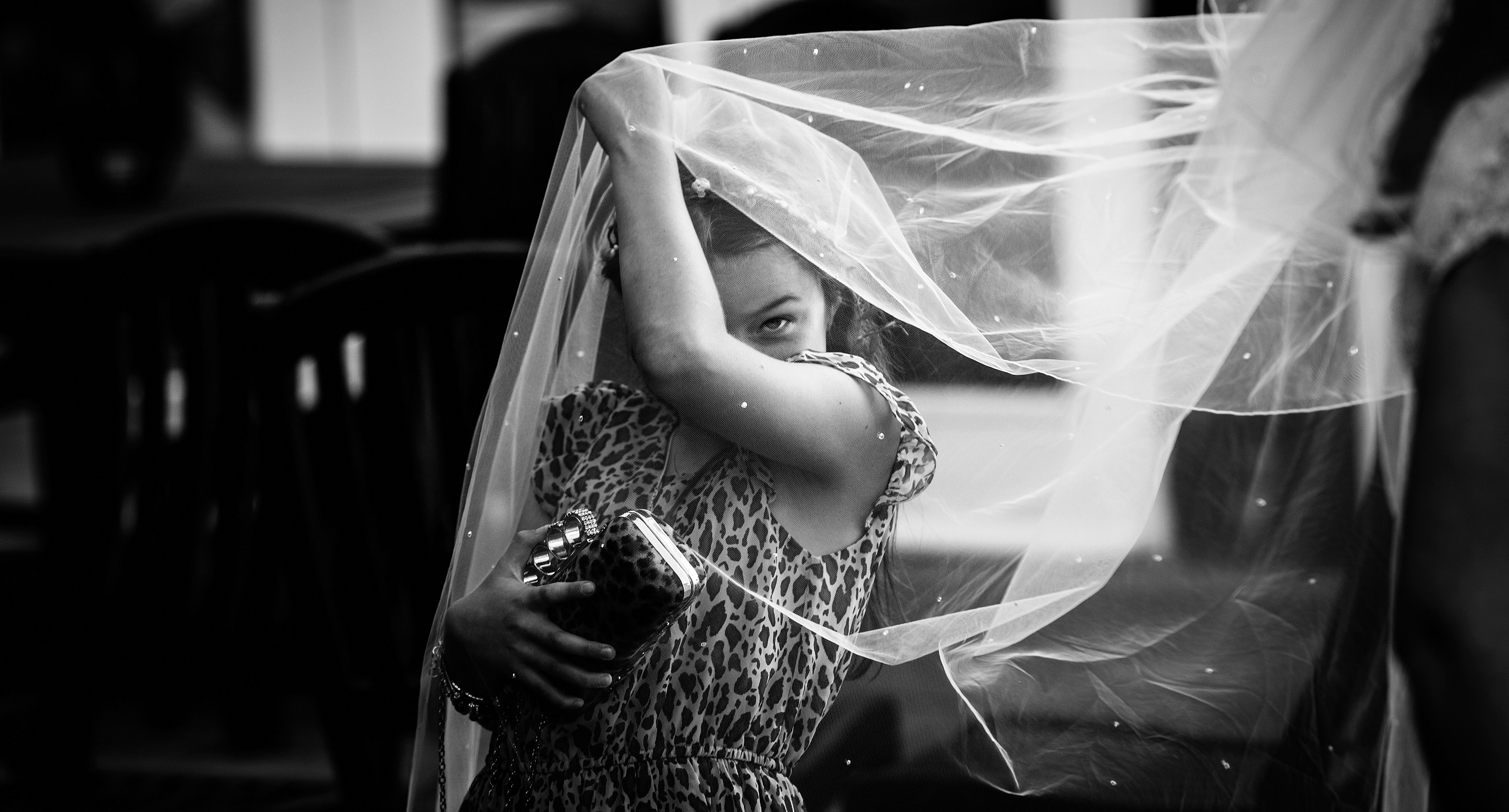 essex wedding photography image of girl with veil