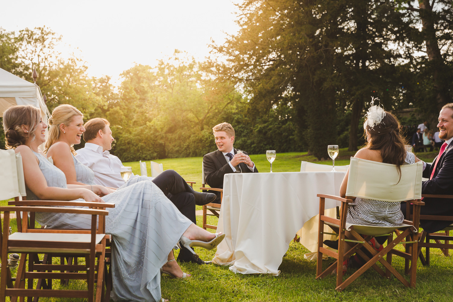 relaxed sunset wedding photograph with outside marquee