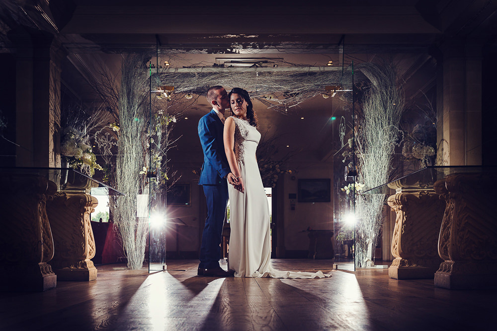 stockbrook manor wedding photography. couple in ceremony room with strong lighting