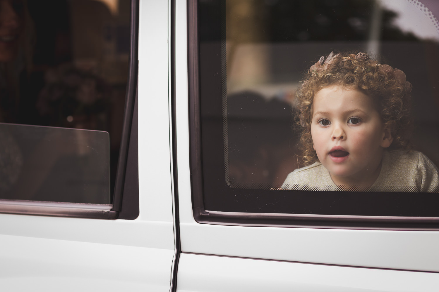 flower girl in London taxi westminster abbey by photographer simon carr