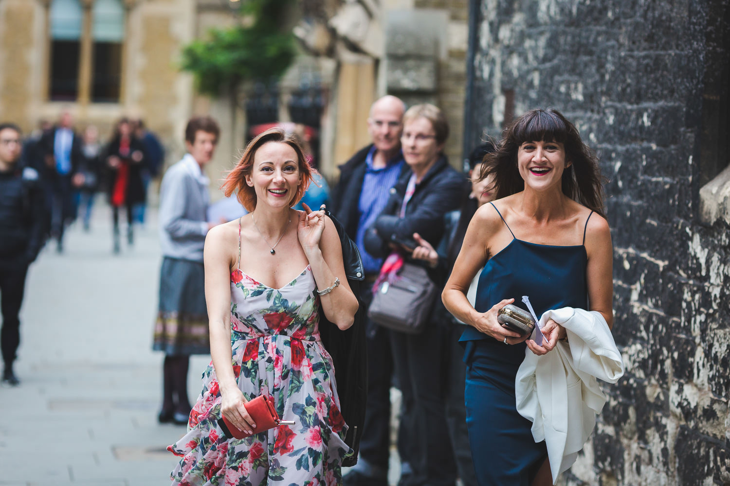 smiling guests arriving for westminster abbey wedding