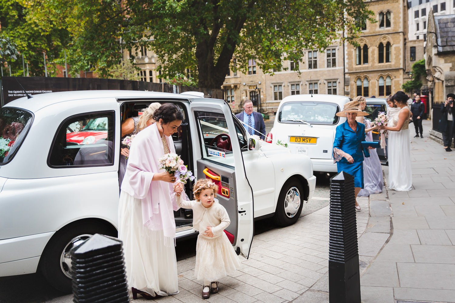 westminster abbey wedding photography bridesmaids arriving by taxi
