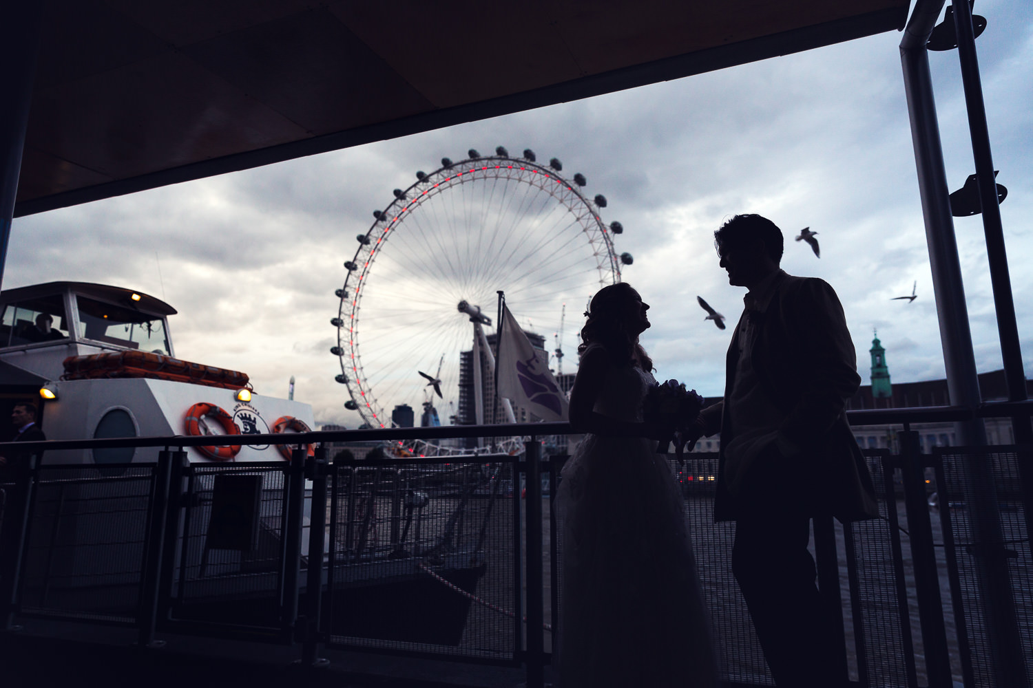 wedding couple with london eye in background
